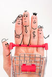 Funny fingers shopping at supermarket with red cart trolley on white background Royalty Free Stock Photos