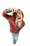 Funny fisheye shoot of young man with camera. Funny fisheye portrait of young man with retro camera royalty free stock photography
