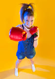 Funny fitness woman with boxing gloves Royalty Free Stock Image