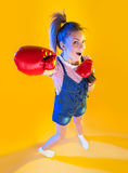 Funny fitness woman with boxing gloves Stock Photo