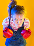 Funny fitness woman with boxing gloves Royalty Free Stock Images