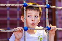 Funny five-year-old boy on playground stock photography