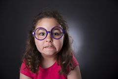 Funny five years girl making faces Stock Photo