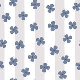 Funny flowers on a striped background. Floral seamless pattern. Royalty Free Stock Images