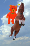 Funny flying bear and horse kites Stock Photos