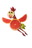 Funny flying chicken made of grapefruit Royalty Free Stock Photo