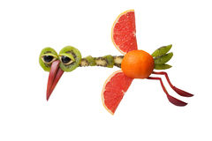 Funny flying heron made of fruits royalty free stock images