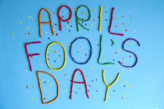 Funny font first april fools day written in plastecine of different colors. 1st April fools day text banner, colorful lettering made from plasticine with royalty free stock photo
