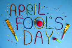Funny font first april fools day written in plastecine of different colors. 1st April fools day text banner, colorful plasticine lettering w/ confetti, party royalty free stock photos