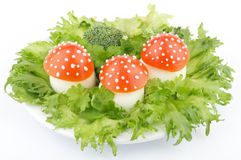Funny food. Fly mushroom formed from boiled egg, cover with the tomato mayonnaise. Funny food for children or party Stock Photo