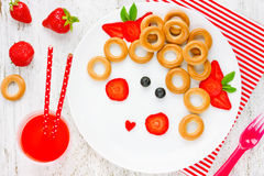 Free Funny Food Art Idea For Healthy Baby Girl Breakfast - Bagels Wit Royalty Free Stock Image - 74700136