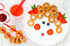 Funny food art idea for healthy baby girl breakfast - bagels wit Royalty Free Stock Image