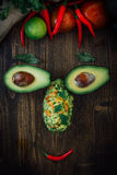 Funny food face made from avocado and guacamole dip. Stock Image
