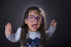 Funny four years girl making faces Stock Photography