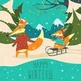 Funny foxes sledding Royalty Free Stock Photos