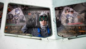 Funny freak man inside the spacecraft Royalty Free Stock Image
