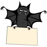Funny freaky bat. A big black fat bat is smiling at you holding a bulletin board (your text can be placed there Royalty Free Stock Photos
