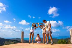Funny friends fooling around in the mountains Royalty Free Stock Photos