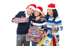Funny friends laughing and holding Xmas gifts Royalty Free Stock Photography
