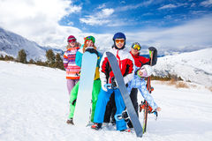 Funny friends with snowboards and skis Royalty Free Stock Photography