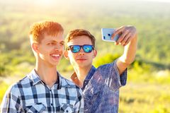Funny friends take selfies on a Sunny day royalty free stock images