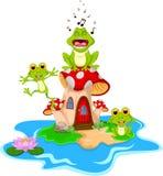 Funny frog cartoon singing on mushroom Royalty Free Stock Photography