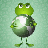Funny frog with green earth Stock Image