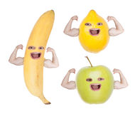 Funny fruit faces showing strong hands. Stock Photo