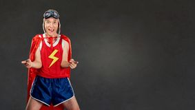 Funny funny cheerful man in a superhero costume. stock photography
