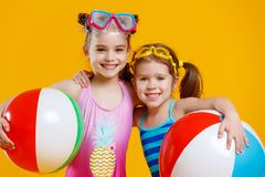 Funny funny happy children in bathing suits and swimming glasses Royalty Free Stock Photos