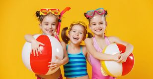 Funny funny happy children  jumping in swimsuit  jumping  on col. Funny funny happy children  jumping in swimsuit and swimming glasses jumping on colored Royalty Free Stock Image