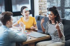 Positive three friends playing game royalty free stock photography