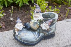 Funny garden gnomes. Sitting on the shoe royalty free stock image