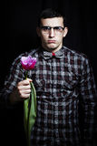 FUNNY GEEK WITH A FLOWER Royalty Free Stock Images