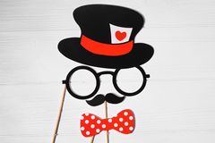 Funny gentleman face created from wedding props Stock Photography