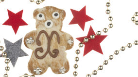 Funny gingerbread bear and stars Stock Images