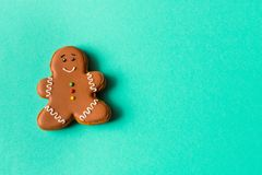 Funny gingerbread man on blue background. Empty text space.  royalty free stock photo