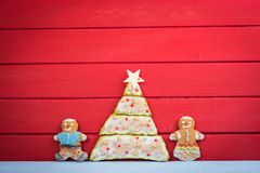 Funny gingerbread man kids with Christmas tree Stock Images