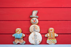 Funny gingerbread man kids with Snowman Royalty Free Stock Photo