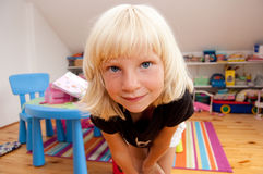 Funny girl. Portrait of a funny looking girl in her room Stock Photography