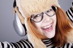 Funny girl. In winter cap and glasses. Studio shot Stock Image
