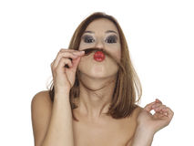 Funny girl. Girl with moustache made with a strand of her hair over her lips Stock Photography