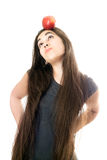 Funny girl with apple. On her head Royalty Free Stock Photography