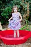 Funny girl in backyard pool Stock Image