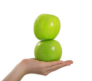 Funny girl balancing on her head with an apple. Isolated on white background royalty free stock photo