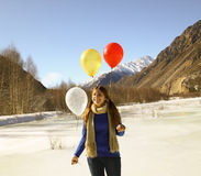 Funny girl with balloons on the hair Stock Photos