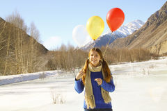 Funny girl with balloons on the hair Royalty Free Stock Image