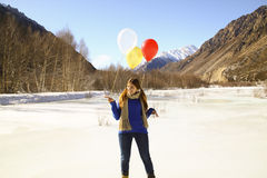 Funny girl with balloons on the hair Stock Images