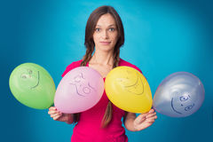 Funny girl with balloons Stock Photography