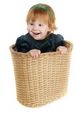 Funny girl in basket Royalty Free Stock Photography